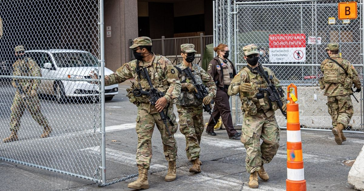 Minnesota National Guardsmen man the gates outside the Hennepin County Government Center in Minneapolis in a March 9 file photo.