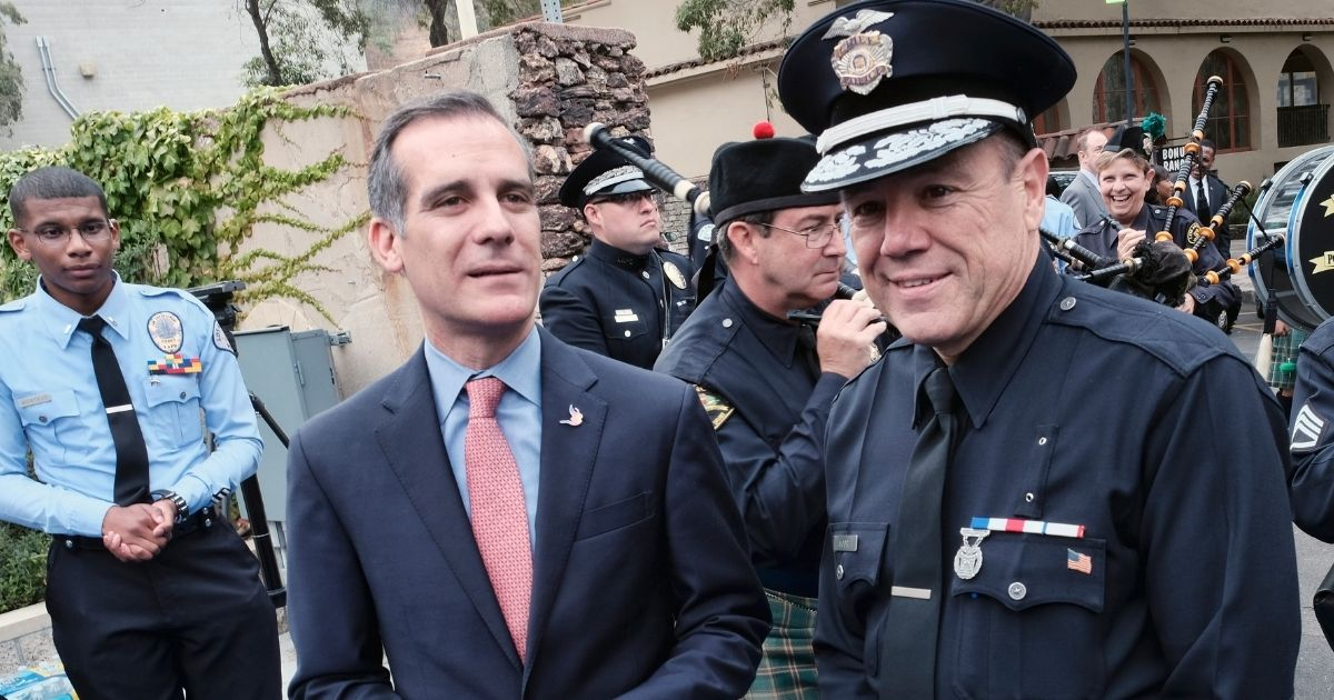 Los Angeles Mayor Eric Garcetti is pictured with Police Chief Michel Moore in a 2018 file photo.