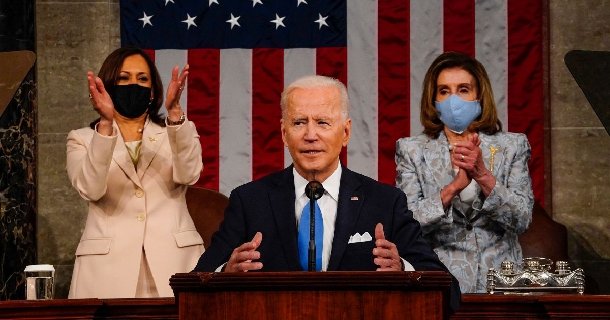 President Joe Biden addresses a joint session of Congress on Wednesday, with Vice President Kamala Harris and House Speaker Nancy Pelosi behind him.