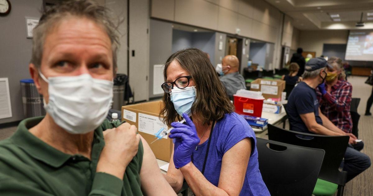 Adams 12 Five Star Schools nurse Lynda Southar, right, gives Scott Stodghill a dose of the Johnson & Johnson COVID-19 vaccine on March 6, 2021, in Thornton, Colorado.
