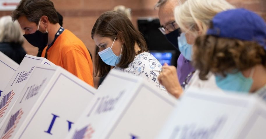 Voters cast their ballots in the voting booths at the early vote location at the Charleston Coliseum and Convention Center in North Charleston, South Carolina, on Oct. 16, 2020.