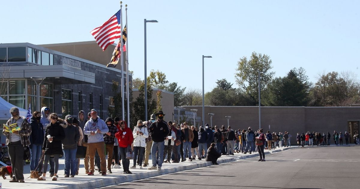 People wait in line to cast their votes at Northern High School, on Nov. 3, 2020, in Owings, Maryland.