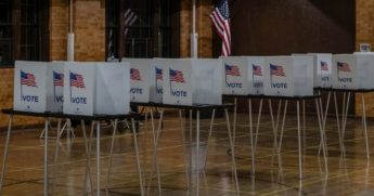 Rows of voting booths are seen in Flint, Michigan, at the Berston Fieldhouse polling place on Nov. 3, 2020.