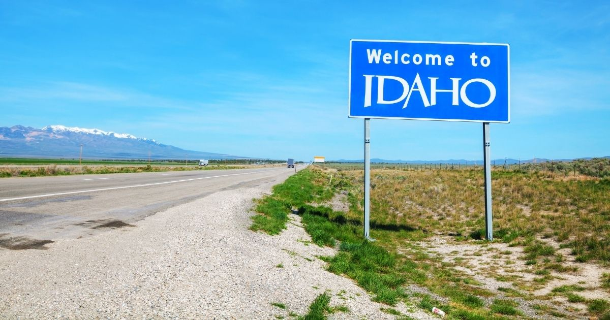 """A """"Welcome to Idaho"""" sign is seen at the state's border."""