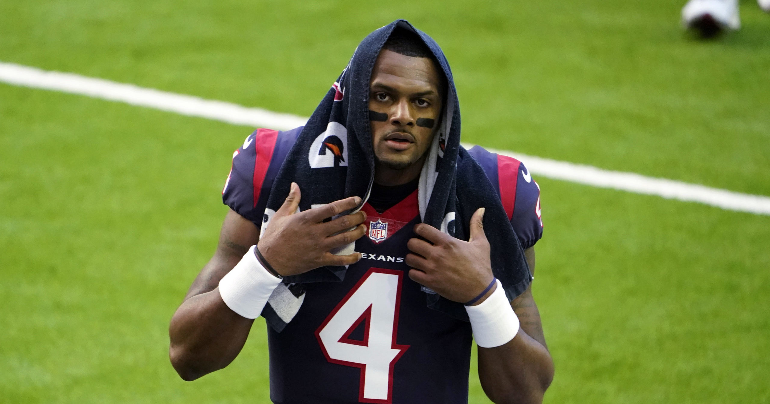 Houston Texans quarterback Deshaun Watson walks off the field before the team's NFL football game against the Tennessee Titans in Houston on Jan. 3, 2021.