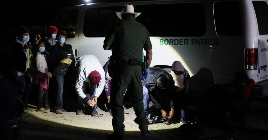A group of illegal migrants is processed by U.S. Border Patrol agents after arriving from Mexico on March 30, 2021, in Roma, Texas.