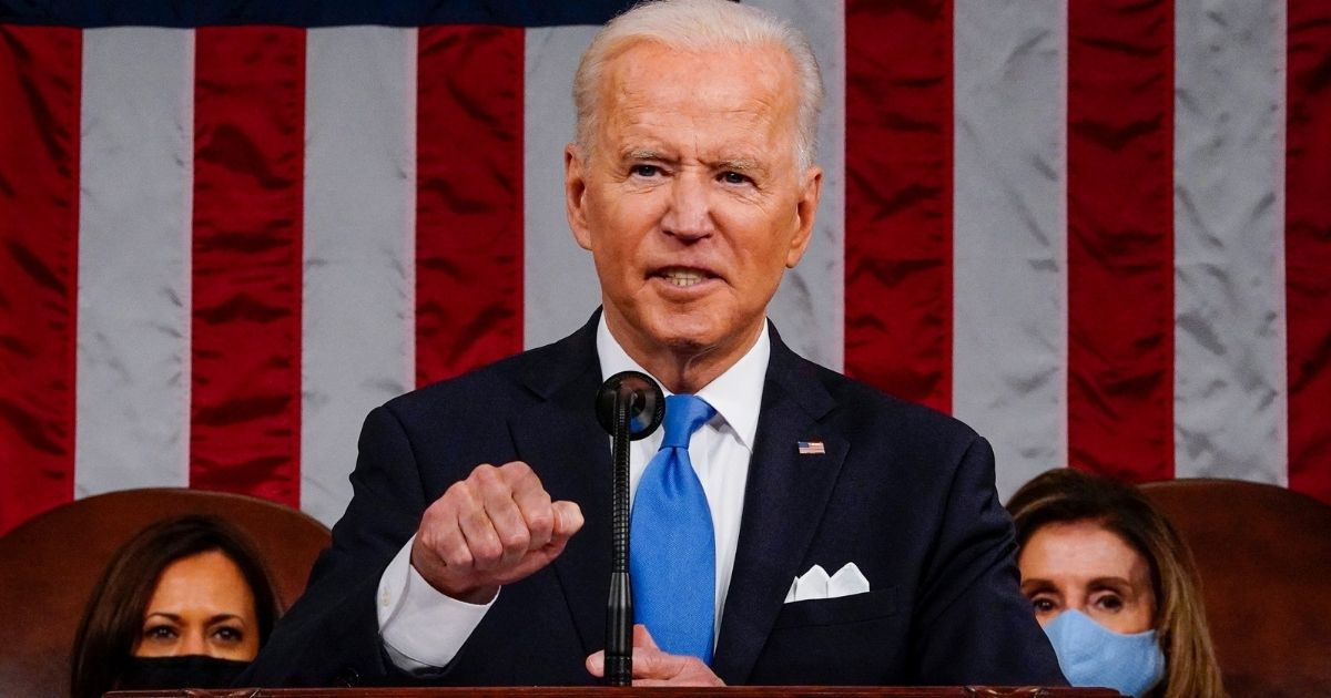 President Joe Biden addresses a joint session of Congress as Vice President Kamala Harris and Speaker of the House Nancy Pelosi look on in the House chamber of the U.S. Capitol on April 28, 2021, in Washington, D.C.