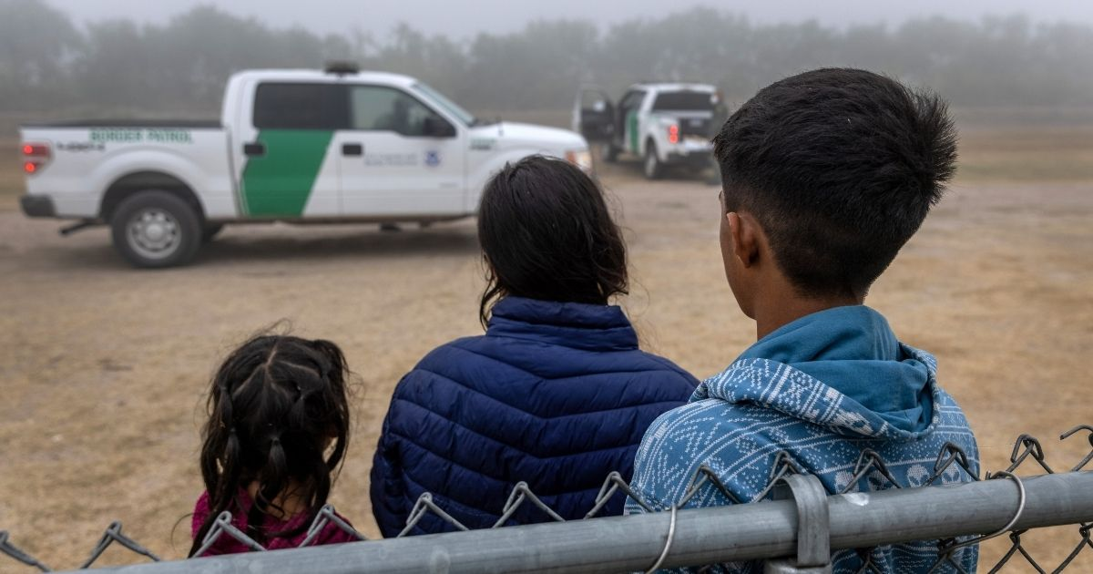 Unaccompanied minors wait to be processed by U.S. Border Patrol agents near the U.S.-Mexico border on April 10, 2021, in La Joya, Texas.