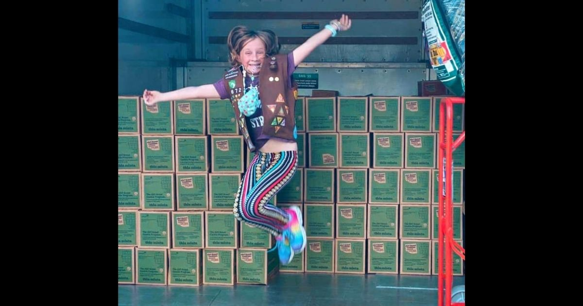 Lilly Bumpus shows off the 5,000 boxes of donated cookies she was able to deliver to kids fighting childhood cancer.