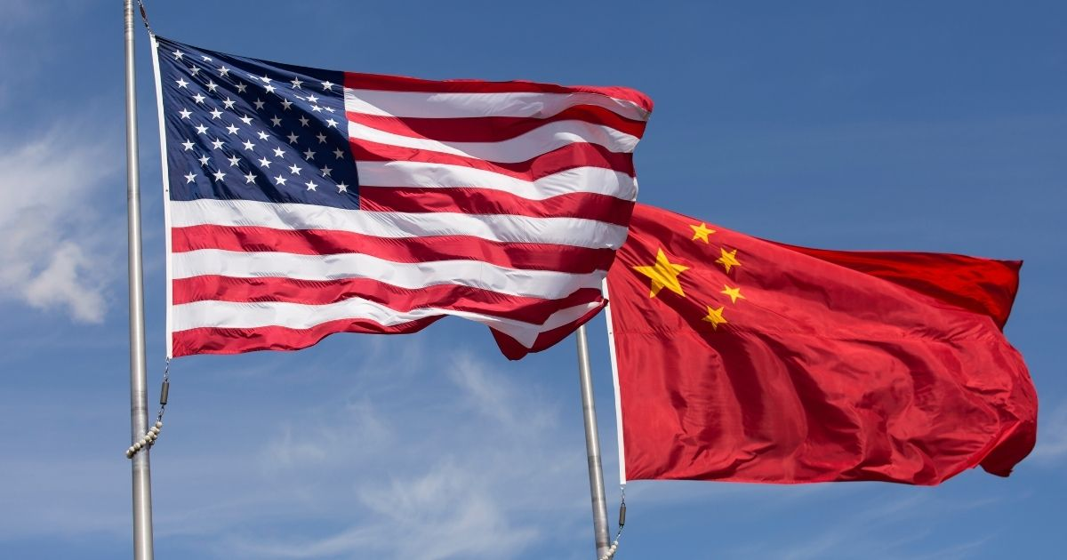 The American and Chinese flags fly in this stock image.