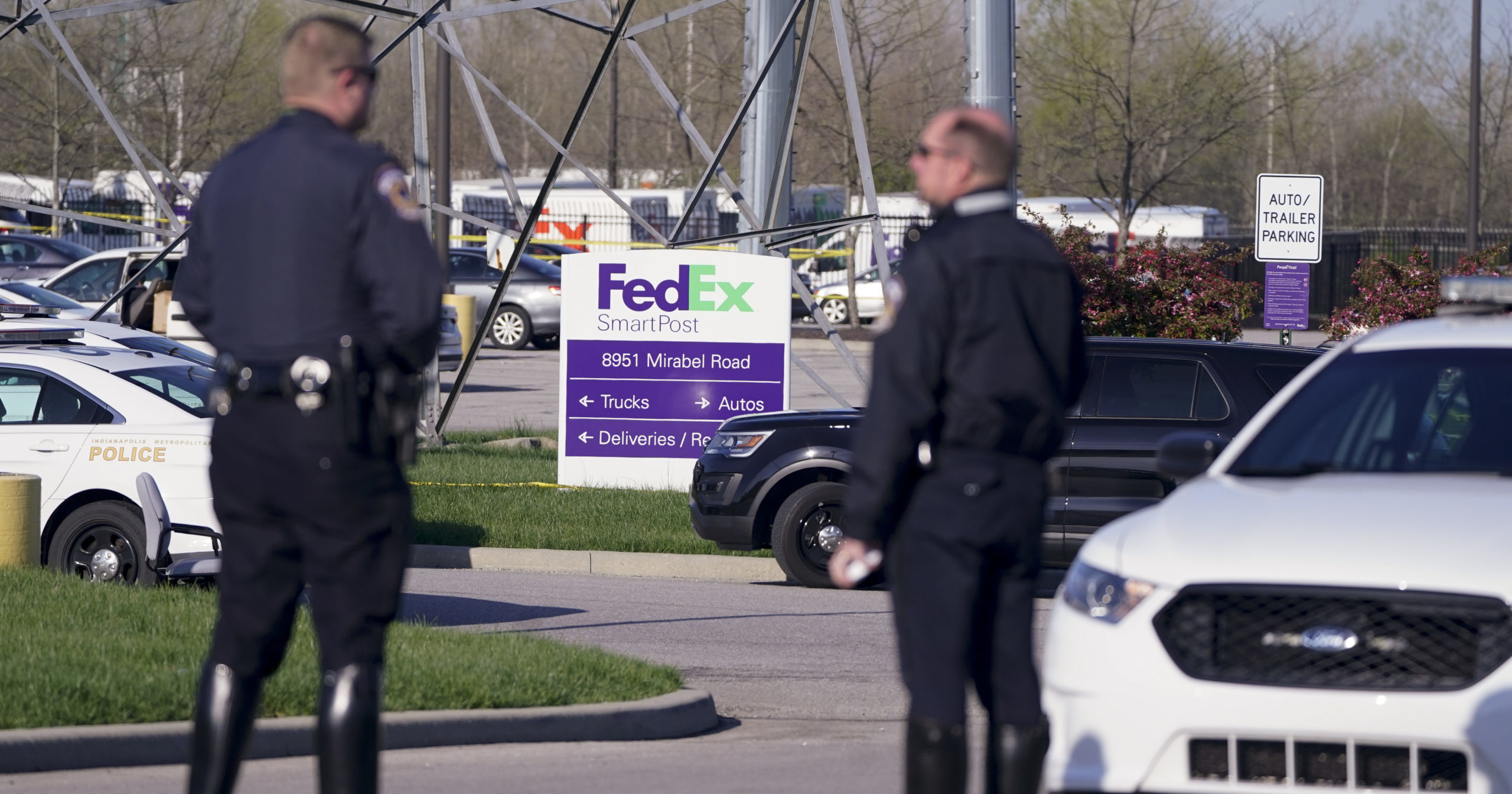 Police stand near the scene of a shooting at a FedEx facility in Indianapolis, Indiana, on April 16, 2021.