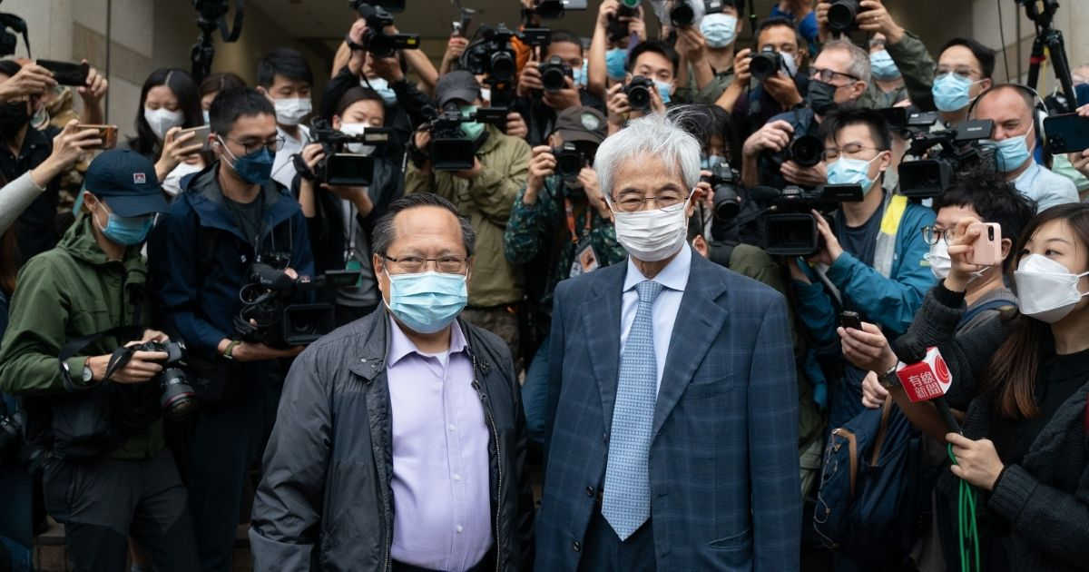 Pro-democracy activists Martin Lee, right, and Albert Ho, left, arrive at a court in Hong Kong on Friday.