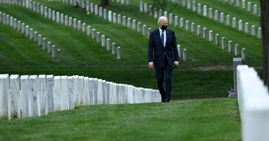 President Joe Biden walks through Arlington National Cemetery in Arlington, Virginia, on Wednesday.