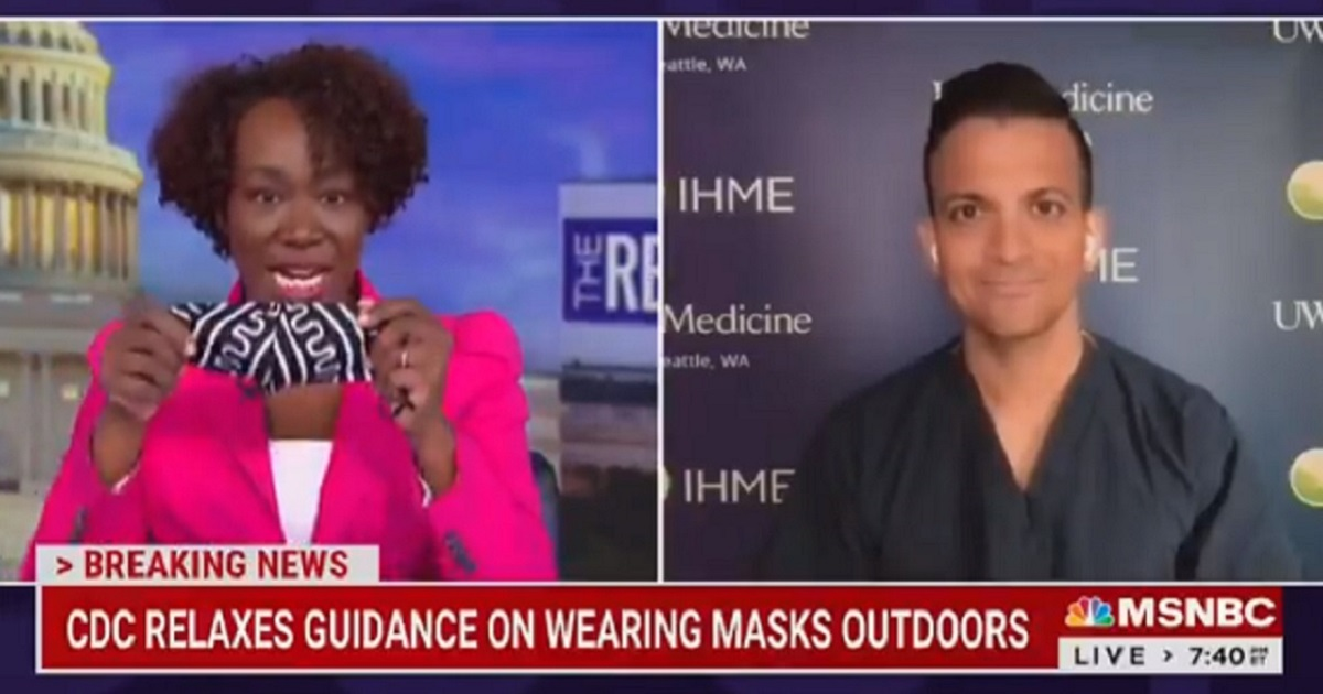 MSNBC's Joy Reid shows off her mask on television Tuesday.