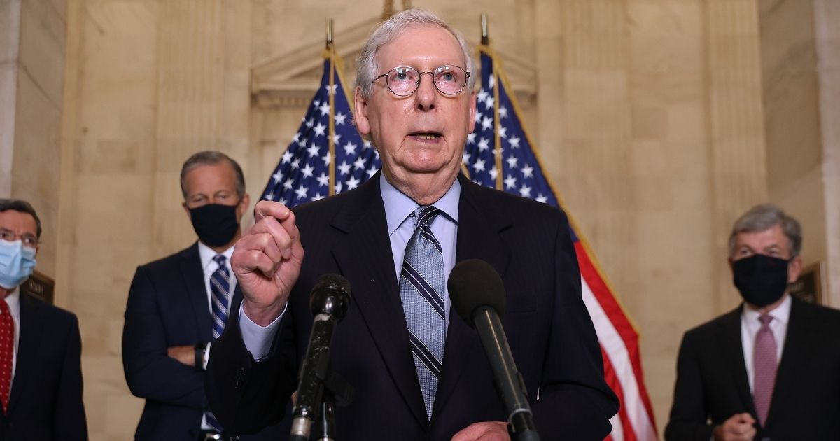Senate Minority Leader Mitch McConnell talks to reporters following the weekly Senate Republican policy luncheon meeting in the Russell Senate Office Building on Tuesday in Washington, D.C.