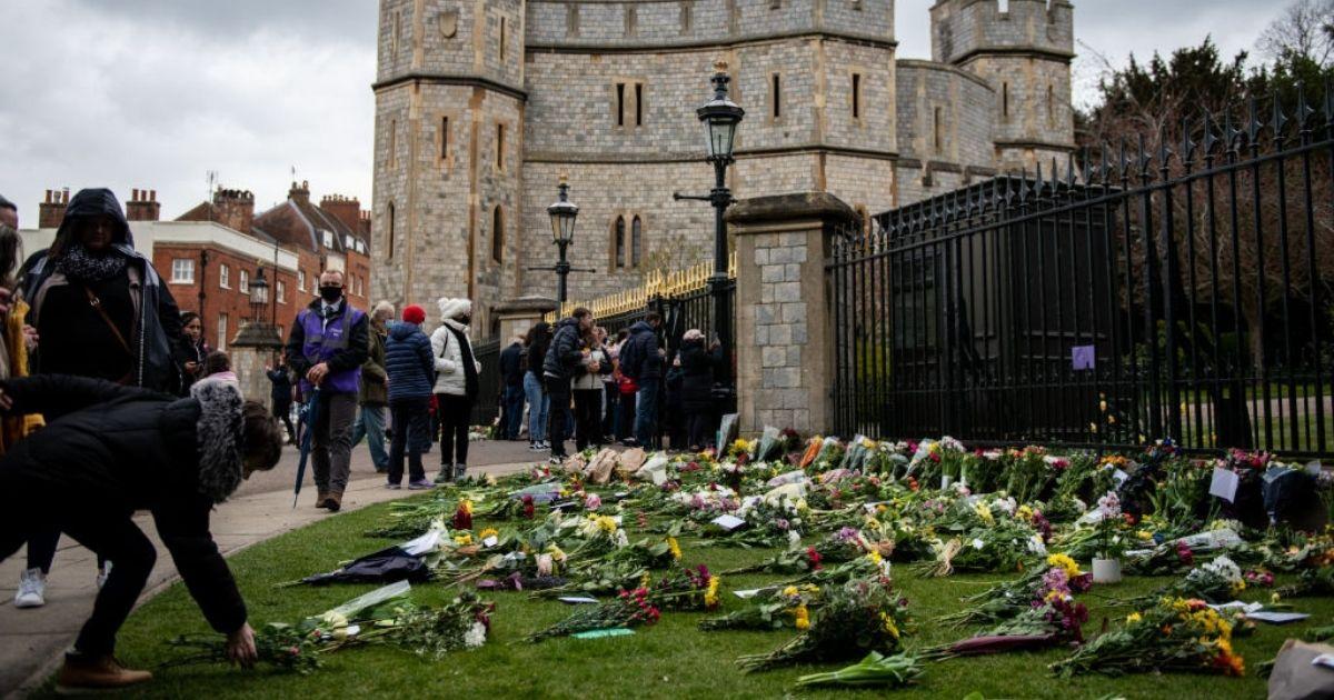 People leave floral tributes to Prince Philip on April 10, 2021, at Windsor Castle in Windsor, United Kingdom.