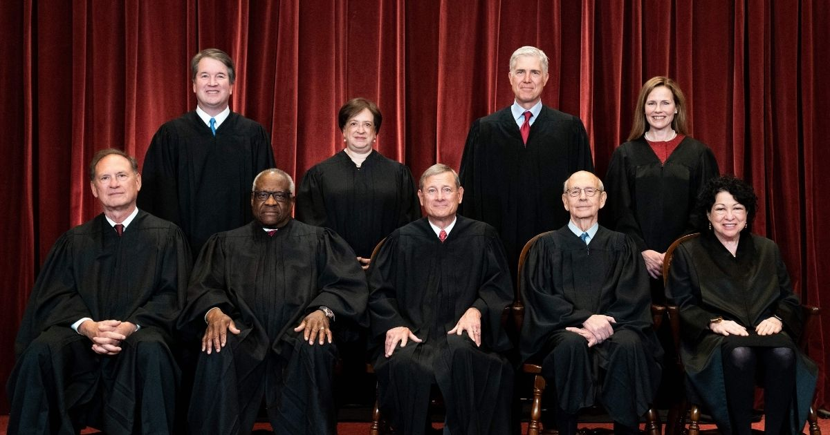 The Supreme Court justices are photographed at the Supreme Court in Washington, D.C., on April 23, 2021.