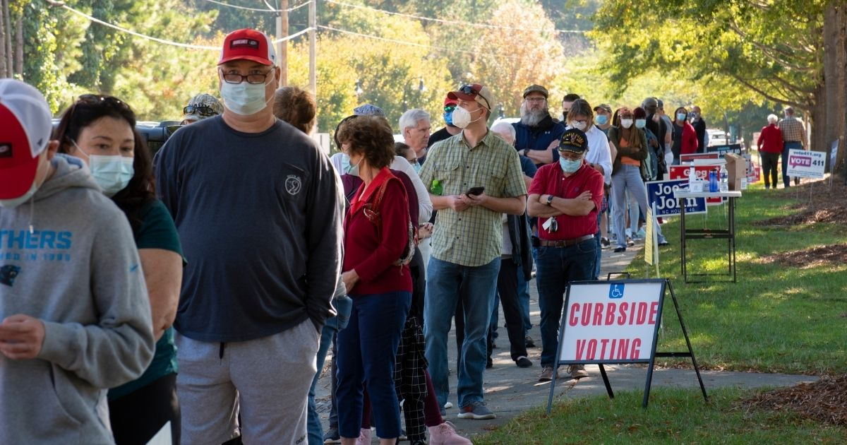 Voters wait in line in the above stock image.