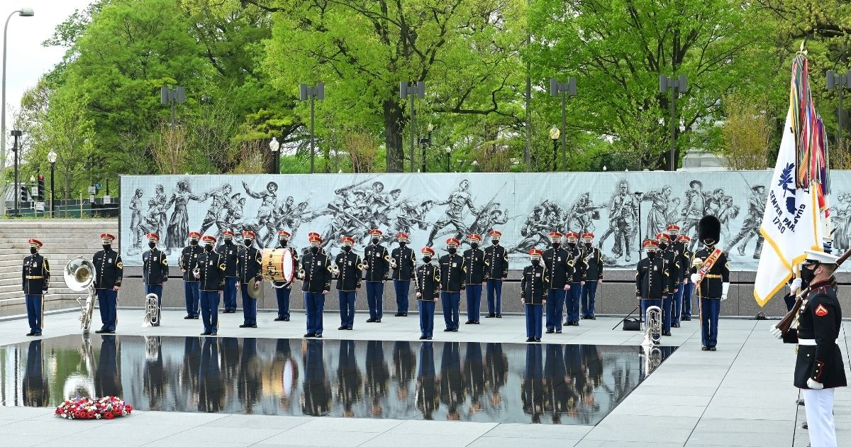 The United States Army Band and members of the Joint Armed Forces Color Guard appear at the World War I Memorial on April 16, 2021, in Washington, D.C.