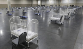 Cots and cribs are arranged at the Mountain America Expo Center in Sandy, Utah, on April 6, 2020, for hospital overflow amid the coronavirus pandemic.