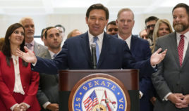 Surrounded by lawmakers, Florida Gov. Ron DeSantis speaks at the end of a legislative session Friday at the Capitol in Tallahassee, Florida.