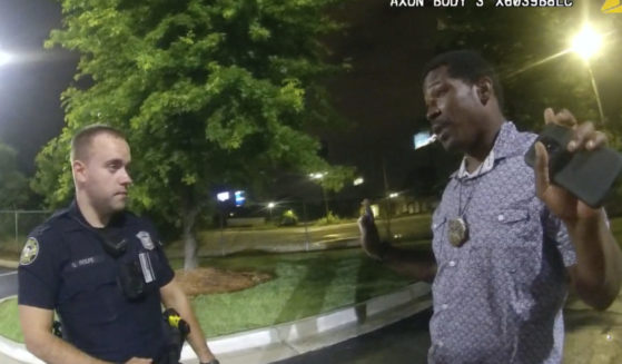 Rayshard Brooks, right, speaks with officer Garrett Rolfe, left, in the parking lot of a Wendy's restaurant in Atlanta on June 12, 2020, in this image taken from body camera video.