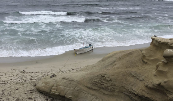 A small boat used during a suspected human smuggling operation sits on a San Diego beach on Thursday.
