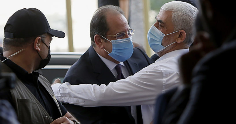 Yehiyeh Sinwar, right, the top Hamas leader in Gaza, hugs head of the Egyptian General Intelligence Abbas Kamel as they meet in Gaza on Monday.