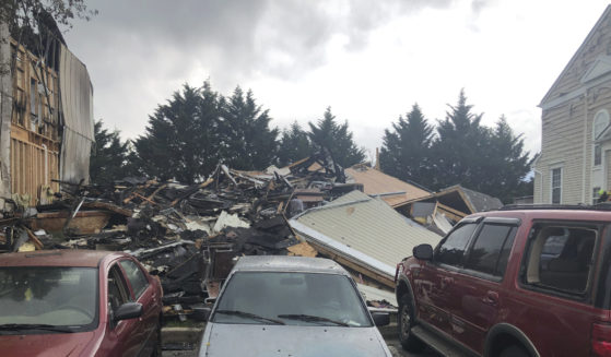 This photo shows the site of a fire in Woodlawn, Maryland, where four people were killed, including a suspect, and two others were injured in a shooting on Saturday.