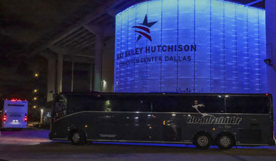 Charter buses arrive at the Kay Bailey Hutchison Convention Center in Dallas on March 17, 2021