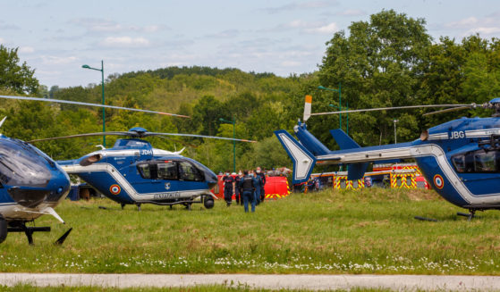 French gendarmes and firemen stand near helicopters in La Chapelle-sur-Erdre, France, on Friday.