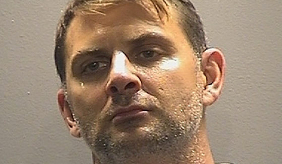 This booking photo shows Peter Debbins, a former Army Green Beret who was sentenced to more than 15 years in prison on Friday on espionage charges.