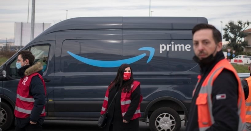 Amazon workers demonstrate for better working conditions near an Amazon Prime delivery truck on March 22, 2021 in Brandizzo near Turin, Italy.