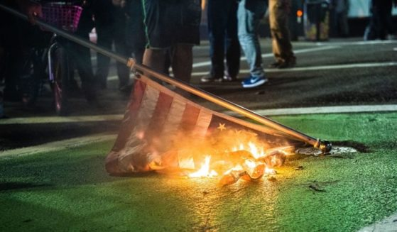 Protesters burn a U.S. flag in Portland, Oregon, on Nov. 4, 2020.