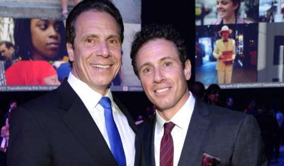 Democratic New York Gov. Andrew Cuomo and CNN host Chris Cuomo attend The Robin Hood Foundation's 2015 Benefit at Jacob Javitz Center on May 12, 2015, in New York City.