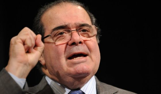 "The late Supreme Court Justice Antonin Scalia speaks during the American Bar Association (ABA) 59th annual ""Antitrust Law Spring"" meeting in Washington, D.C., on March 31, 2011."