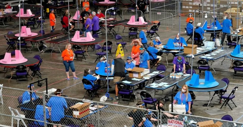 Maricopa County ballots cast in the 2020 general election are examined and recounted by contractors working for Florida-based company Cyber Ninjas on May 6, 2021, at Veterans Memorial Coliseum in Phoenix.