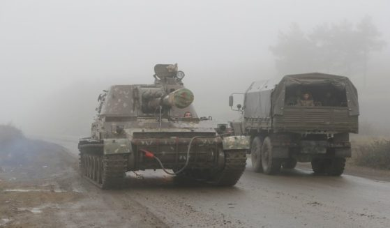 An Armenian self-propelled artillery unit rolls on a road during the withdrawal of Armenian troops from the separatist region of Nagorno-Karabakh, on Nov. 18, 2020.
