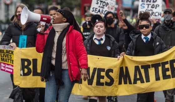 Black Lives Matter activist Sasha Johnson speaks at a protest as BLM supporters march from Park View School to Tottenham Police Station on Dec. 11, 2020, in London, England.