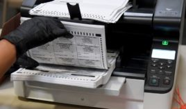 An election worker scans mail-in ballots at the Clark County Election Department in North Las Vegas, Nevada, on Nov. 7.