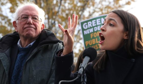 Vermont independent Sen. Bernie Sanders, left, and New York Democratic Rep. Alexandria Ocasio-Cortez hold a news conference to introduce legislation to transform public housing as part of their Green New Deal proposal outside the U.S. Capitol on Nov. 14, 2019, in Washington, D.C.