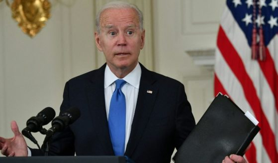 President Joe Biden gestures during an event in the State Dining Room of the White House in Washington on Wednesday.