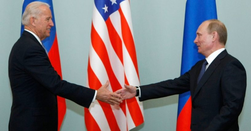 Then-Vice President Joe Biden shakes hands with Russian Prime Minister Vladimir Putin in Moscow on March 10, 2011.