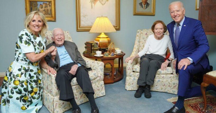 President Joe Biden, far right, and his wife Jill Biden, far left, take a photo with former President Jimmy Carter, center left, and his wife Rosalynn Carter.