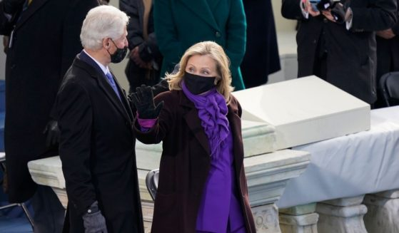Former President Bill Clinton and former Secretary of State Hillary Clinton arrive for the 59th Presidential Inauguration at the U.S. Capitol in Washington on Jan. 20, 2021.