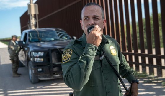 U.S. Border Patrol agent Carlos Ruiz spots a pair of undocumented immigrants while coordinating with active duty U.S. Army soldiers near the U.S.-Mexico border fence on Sept. 10, 2019, in Penitas, Texas.