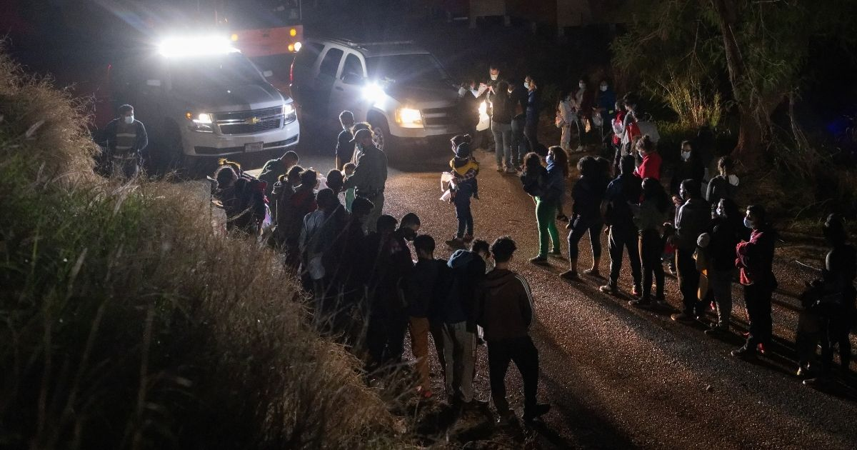 U.S. Border Patrol agents process immigrant families after they crossed the Rio Grande into south Texas on Thursday in Roma, Texas.