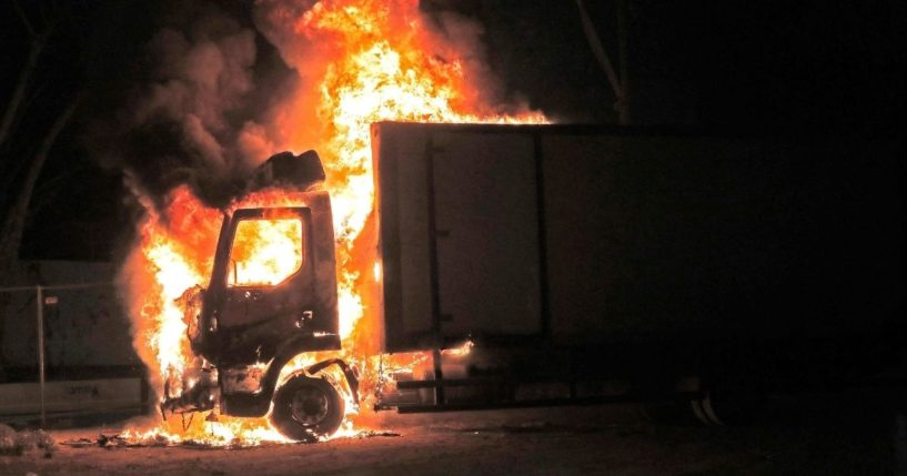 A truck burns at the entrance of the mixed Jewish-Arab city of Lod, where a state of emergency has been declared following civil unrest, on Wednesday.