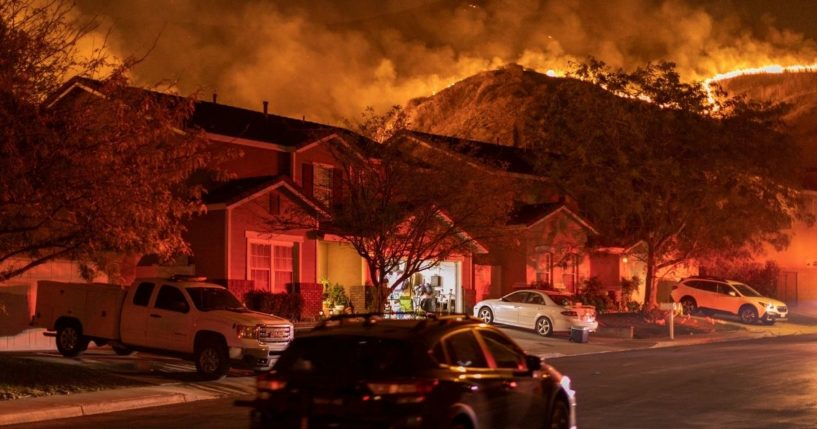 Flames come close to houses during the Blue Ridge Fire on Oct. 27, 2020, in Chino Hills, California.