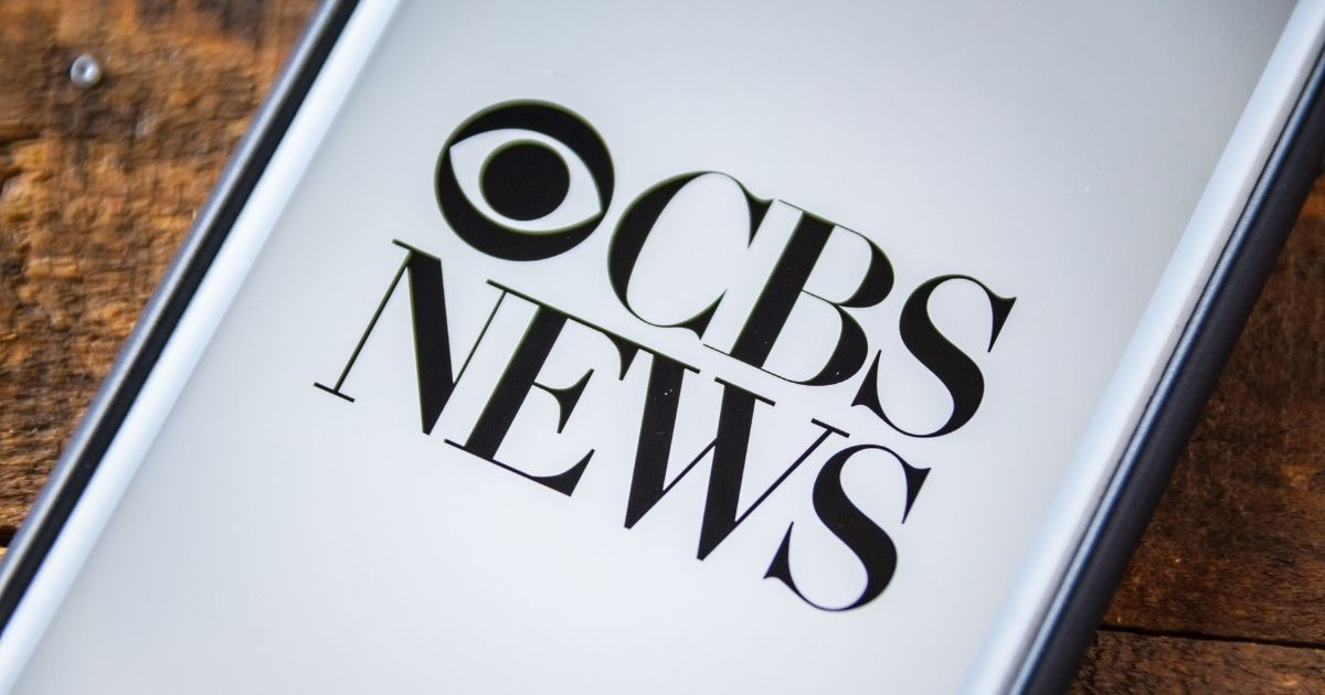 The CBS News app is pictured on a smartphone in the stock image above.